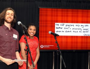 A photo of two Carleton students speaking at a reception