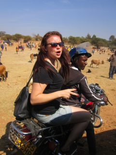 Alana riding a piki-piki in Kondoa, Tanzania.