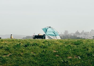 Photograph of tent with city in background