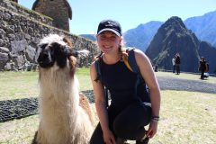 Image of student and a Llama in Peru. Student was on an International Placement in Peru.