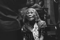 East Asian elderly woman looking up - photograph in black and white