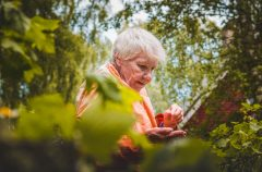 Elderly woman in forested area
