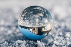 Crystal ball with reflecting blurry and reversed image of building
