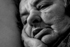 Elderly woman resting her head - black and white photograph