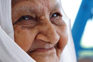 Smiling elderly woman in head scarf