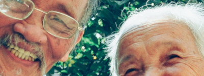 Faces of senior East Asian couple