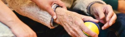 Younger hands holding elderly hands