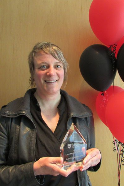 2017 Co-op Employer of the Year, Ilona Naujokaitis-Lewis, poses with her award.