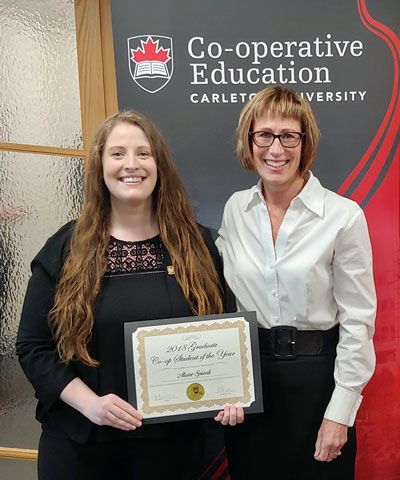 Alaine Spiwak, winner of the 2018 Graduate Student of the Year Award, holding her Co-op Student of the Year certificate while standing with Kathleen Hickey, Manager of Co-operative Education.