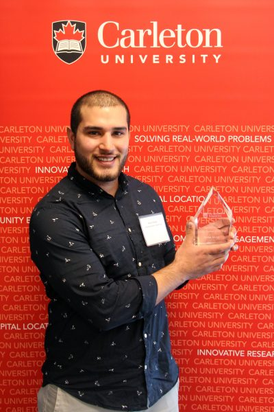 2016 Undergraduate Co-op Student of the Year, Stefan Murga, with his award at the 2016 Co-op Awards ceremony.