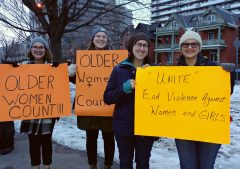 Women hold up their anti-VAW signs at the march December 1.