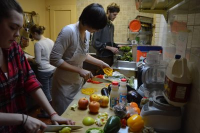Members of the Carleton Food Collective help prepare meals for serving to students.