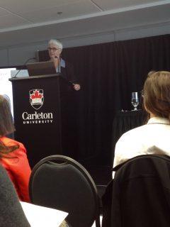 Diana Majury speaking at a podium