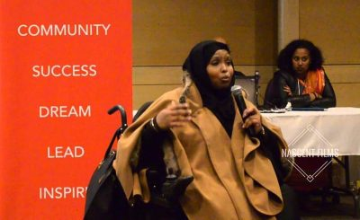 Kawsar Mohamed, CCEC Administrative Research Assistant, speaks at an event for Somali Youth.