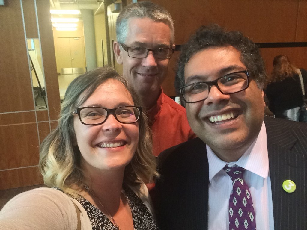 Katherine Topolnski and Peter Andree pose for a selfie with Mayor Nenshi.