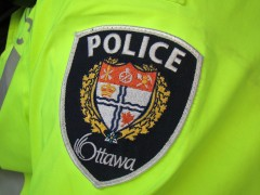 Ottawa Police Badge on a neon yellow jacket.