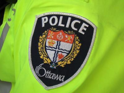 Ottawa Police Badge on a neon yellow jacket.