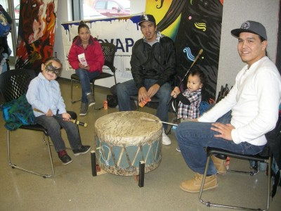 Teaching the younger generation about ceremonial drumming at Station 20 West.