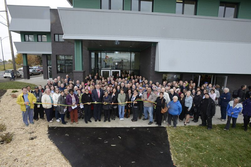 Station 20 West ribbon cutting ceremony in front of the brand new building.