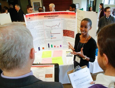 A student explains her project to listeners at TCRC's Community Engagement Forum April 7, 2016.