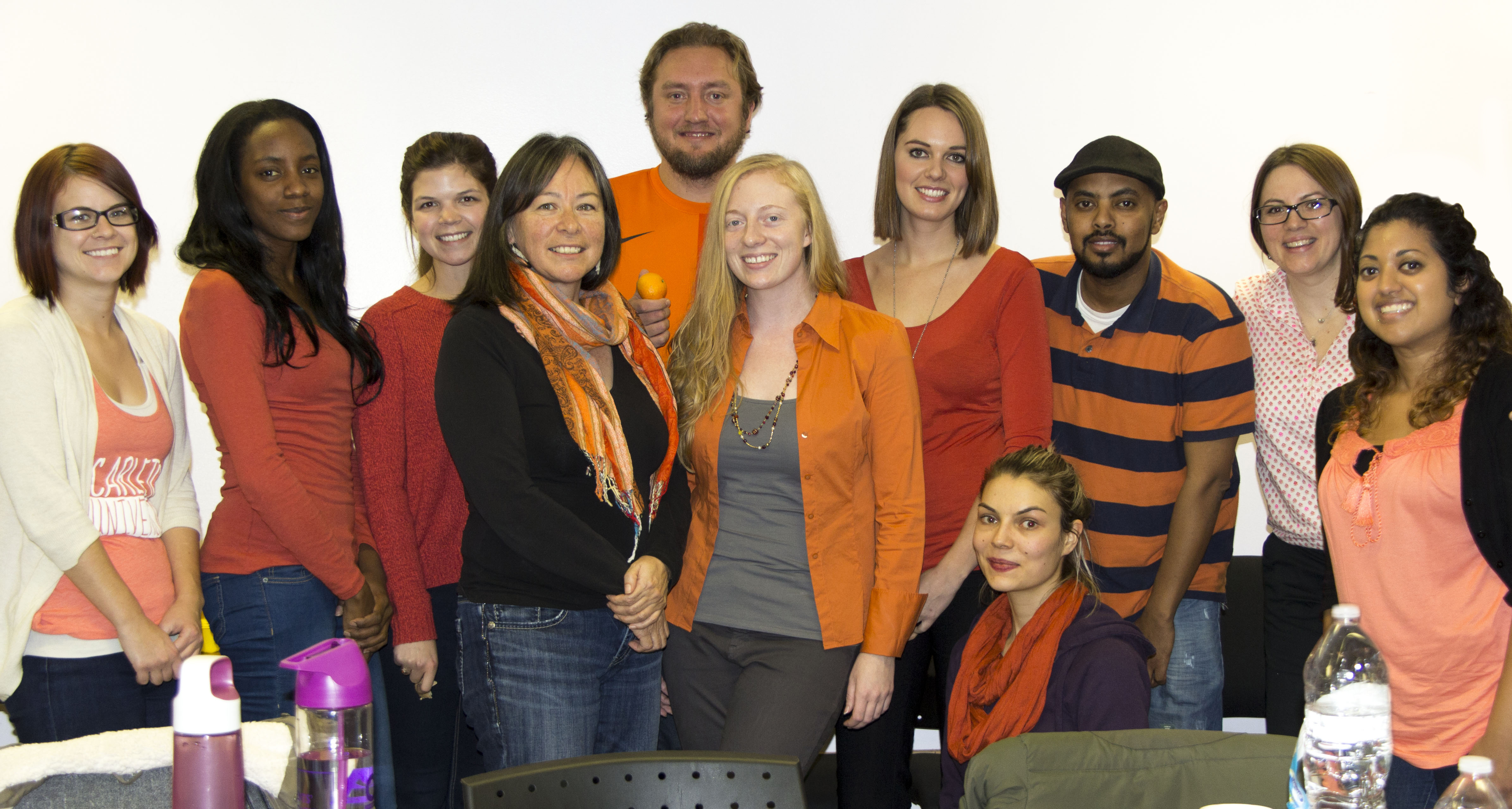 The SOWK 4204 class poses in their orange for a group photo.