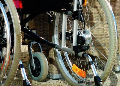 Close up of the back wheels of a wheelchair.