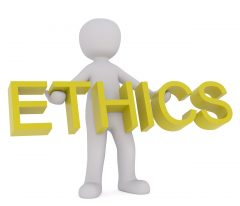 """A stick figure holding the word """"Ethics""""."""
