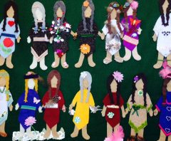 Missing and Murdered Indigenous women and girls made out of different coloured felts on a green background.