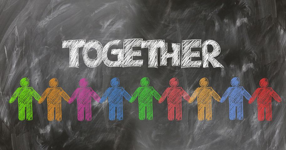 "Picture of a blackboard with the word ""together"" written on it."