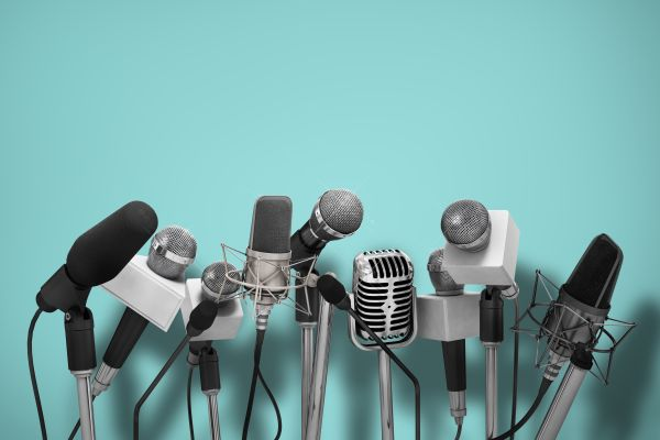 microphones on a turquoise background