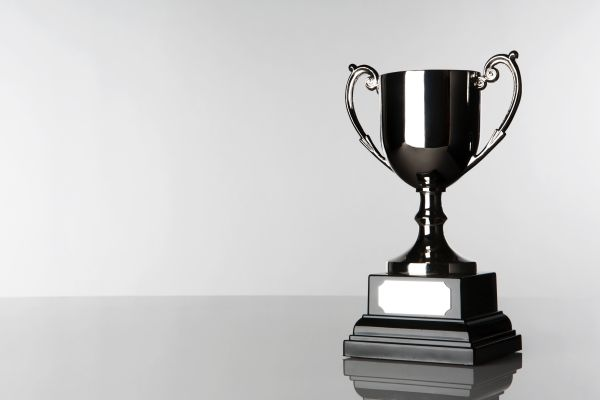 silver trophy on white and grey background 600x400