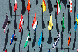 Overhead view of many international flags