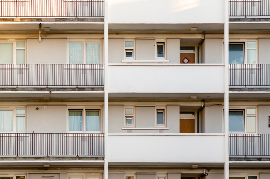 Close-up of balconies of tall apartment building