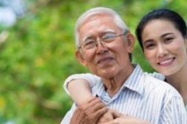 Vietnamese woman embracing older Vietnamese man