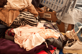 Floor covered with cluttered piles of belongings