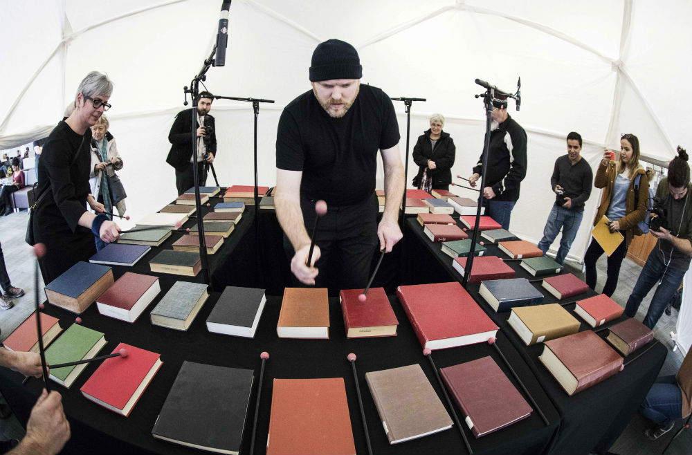Jesse Stewart plays the bibliophone in the geodesic dome surrounded by students