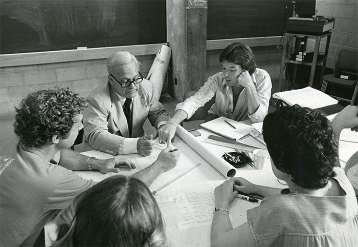 """Store front architecture"" students and an instructor engage in conversation, summer 1977. Library Special Collections fonds."