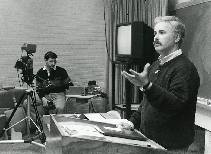 Professor lecturing to an ITV class, ca. 1985. Library Special Collections fonds.