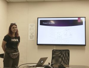 Bohdana Sereda explaining threat analysis on an autonomous emergency braking system.