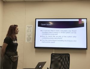 Bohdana Sereda discussing the open issues related to threat modelling and security-by-design.