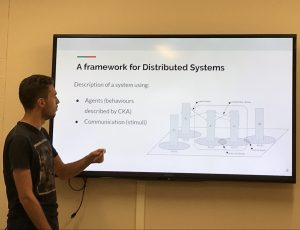 Maxime Buyse presenting the algebraic framework for specifying distributed systems that he formally verified during his research internship within the CyberSEA Research Lab.
