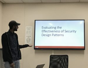 Pruthvi Chivukula presenting his research work on Evaluating the Effectiveness of Security Design Patterns during a CyberSEA Research Lab group meeting.