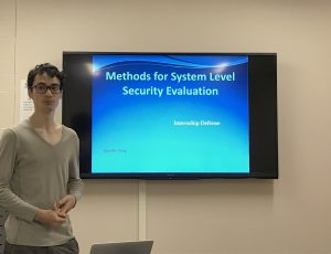 Quentin Yang presenting his research work on Methods for System-Level Security Evaluation during a CyberSEA Research Lab group meeting.