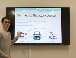 Quentin Yang presenting the details of his attack success metric with respect to implicit interactions in distributed systems.