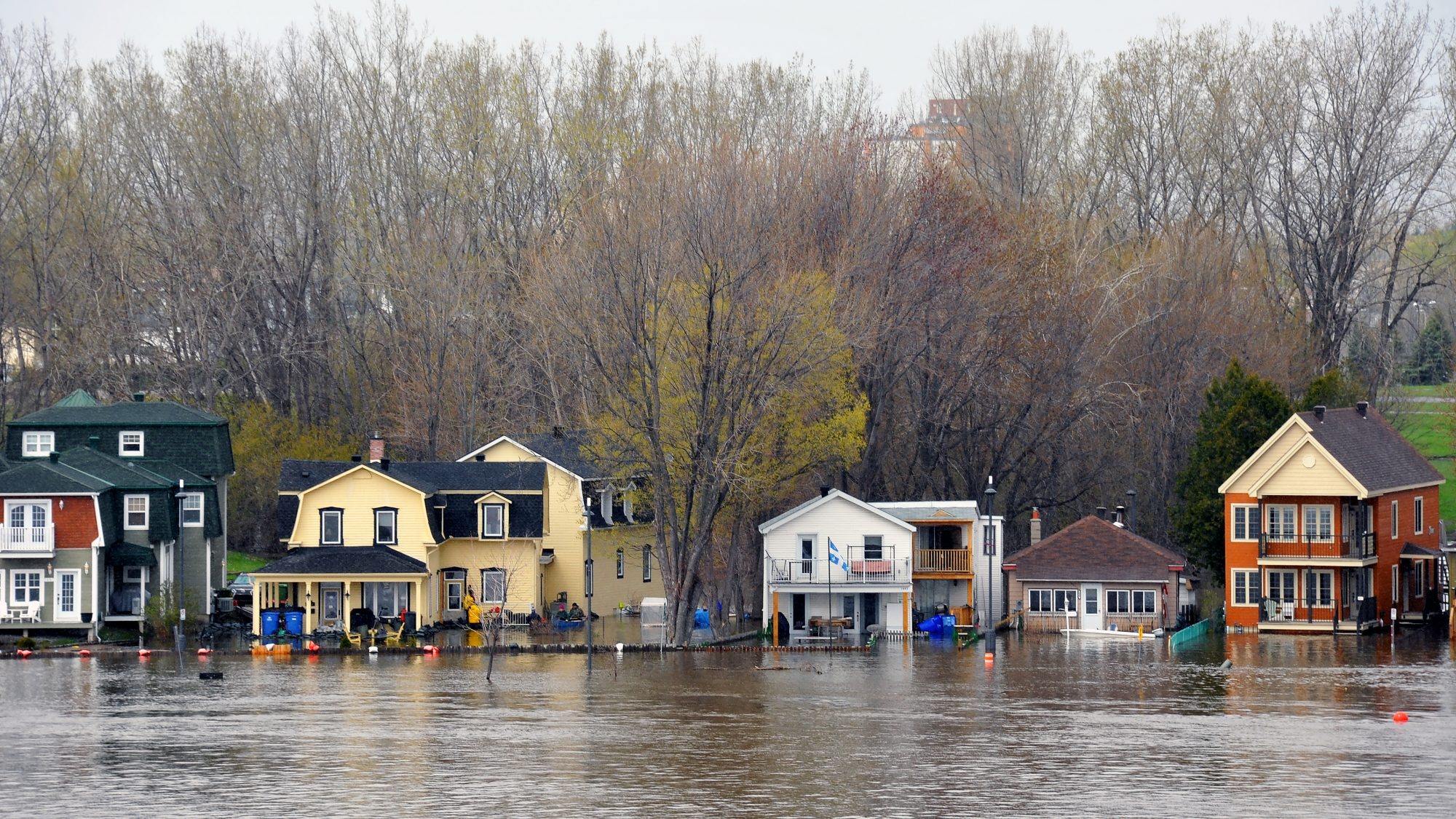 Paul McKinnon Gatineau, Canada - May 8, 2017: The severe flooding on the Quebec side of the swollen Ottawa River. Pointe Gatineau is one of several areas in North America that has suffered flood conditions.