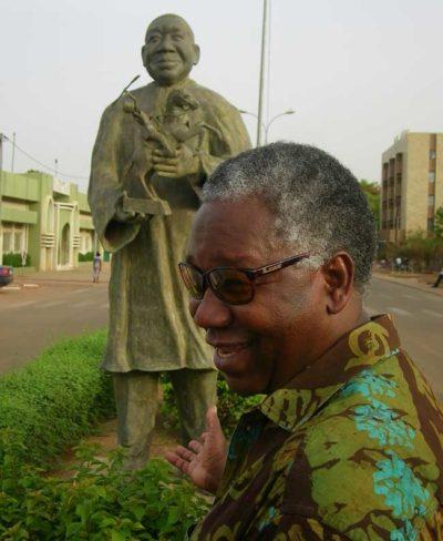 Filmmaker Gaston Kaboré visits his own statue.