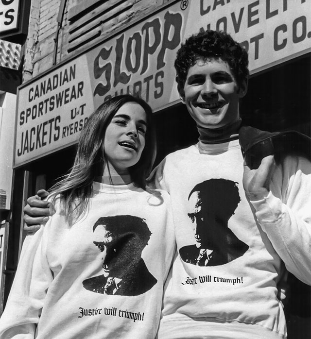 A young man and young woman with Trudeau sweatshirts