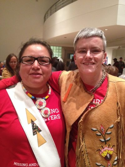 Juliana Matoush Snowboy and Sharp Dopler (Photo by Sandra Dyck). Juliana and Sharp were among the local Elders who guided the WWOS Ottawa committee, providing guidance on ceremony and protocol and volunteering many hours in the gallery during the presentation of WWOS.