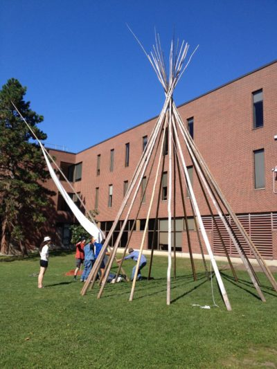 Setting up the tipi (Photo by Sandra Dyck).Pinock Smith and his crew moved the tipi from the lawn outside Robertson Hall to the lawn between St. Patrick's Building and Russell House on Friday, September 18th. The Centre for Aboriginal Culture and Education graciously lent the tipi for to the gallery during the presentation of WWOS.