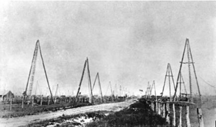 Some rudimentary oil derricks near Petrolia, Ontario, 1860s. This was the site of the world's first oil boom, and a relatively unknown chapter in the history of oil.
